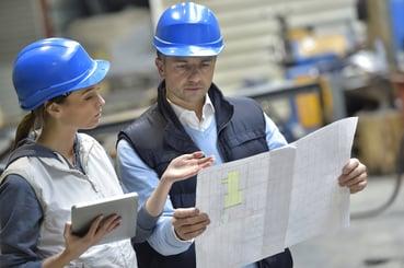 MEP Engineers review drawings in the field